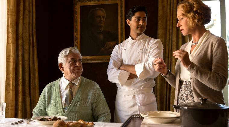 """HFJ-0087r In DreamWorks Pictures' charming new film """"The Hundred-Foot Journey,"""" Hassan (MANISH DAYAL, center) serves his father (OM PURI) Beef Bourguinon á la Hassan, a classic French dish with an Indian twist, as Madame Mallory (HELEN MIRREN) explains its significance to French chefs. Photo: Francois Duhamel ©DreamWorks II Distribution Co., LLC. All Rights Reserved."""