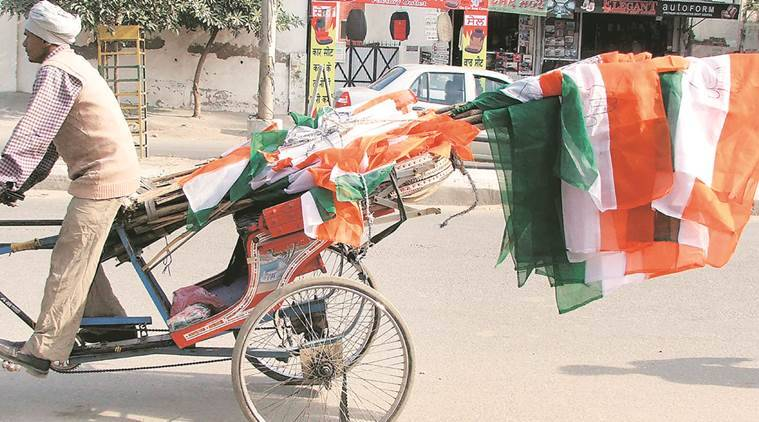 Congress flags being carted from one rally venue to another in Moga. (Express Photo by Gurmeet Singh)