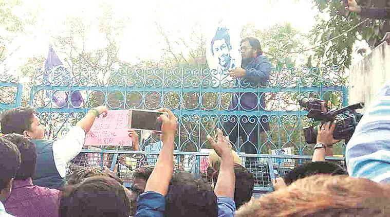 Students protest at the gate of the university. Express