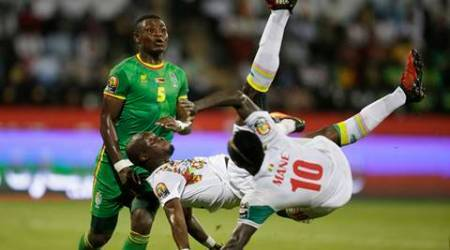 Senegal's, Moussa Sow, centre, Sadio Mane, right, and teammate in action by Zimbabwe's Elisha Muroiwa, left, during the African Cup of Nations Group B soccer match between Senegal and Zimbabwe at Stade de Franceville Stadium in Franceville, Gabon, Thursday Jan. 19, 2017. (AP Photo/Sunday Alamba)