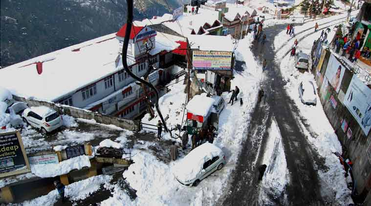 A view of snow covered road after heavy snowfall in Shimla on Monday. (PTI Photo)
