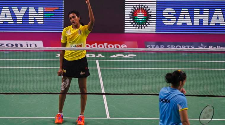 India's PV Sindhu, left, of Chennai Smashers reacts after scoring a point against Saina Nehwal of Awadhe Warriors during women's singles first semi final at the Indian Premier Badminton League in New Delhi, India, Friday, Jan. 13, 2017. Sindhu won the match 7-11, 8-11. (AP Photo/Altaf Qadri)