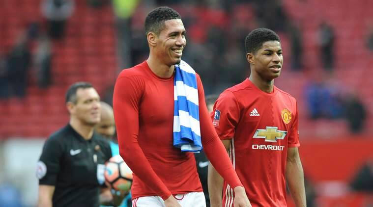 Manchester United's Chris Smalling, left and Manchester United's Marcus Rashford smile as they walk off the pitch following the end of the English FA Cup Third Round match between Manchester United and Reading at Old Trafford in Manchester, England, Saturday, Jan. 7, 2017. United won the game 4-0. (AP Photo/Rui Vieira)