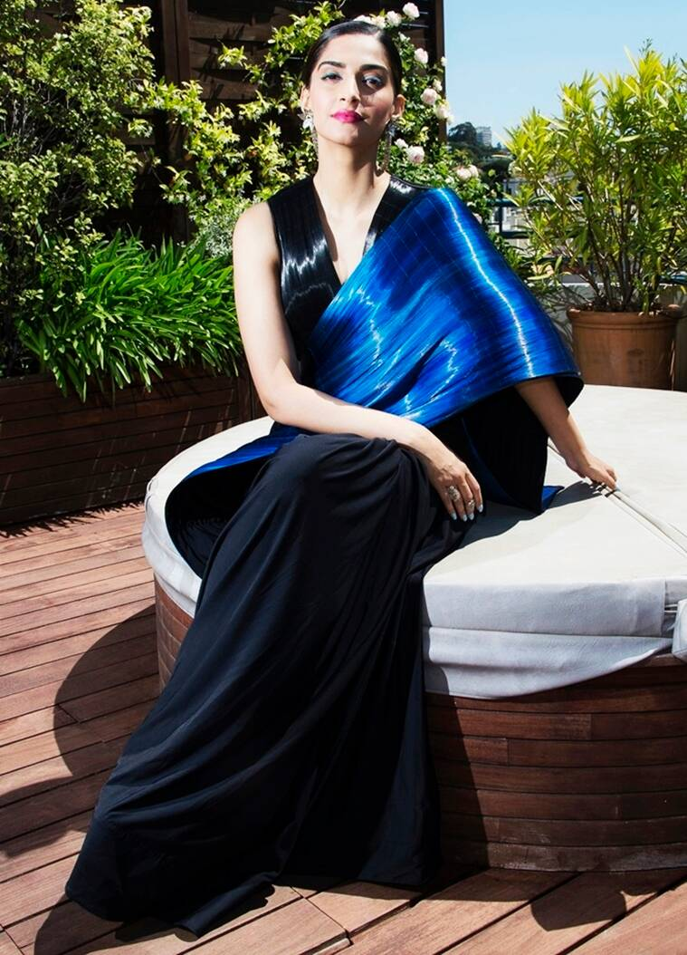 Fashionista Sonam Kapoor turned up the heat in a metallic structured black and blue sari by designer Rimzim Dadu at the 69th annual Cannes Film Festival. With hair in a bun, the actor finished out her look with Suhani Pittie earrings and fuchsia lips. (Photo: AP)