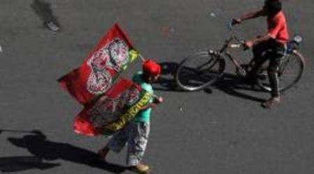 A Young Child holds Samajwadi Party's symbol Flag during party organised Road show in Lucknow on Monday. Express Photo by Vishal Srivastav. 28.04.2014.