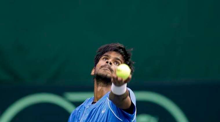India's Sumit Nagal serves during his Davis Cup men's tie against Spain's Marc Lopez in New Delhi, India, Sunday, Sept. 18, 2016. (AP Photo /Tsering Topgyal)