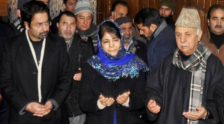 Srinagar: Chief Minister of Jammu and Kashmir Mehbooba Mufti, along with her brother Tasaduq Mufti (L), with party workers pay tribute to their father and former Chief Minister Mufti Mohammad Syed on his first death anniversary, in Srinagar on Saturday. PTI Photo(PTI1_7_2017_000170B)