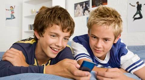 Teenage boys with cell phone