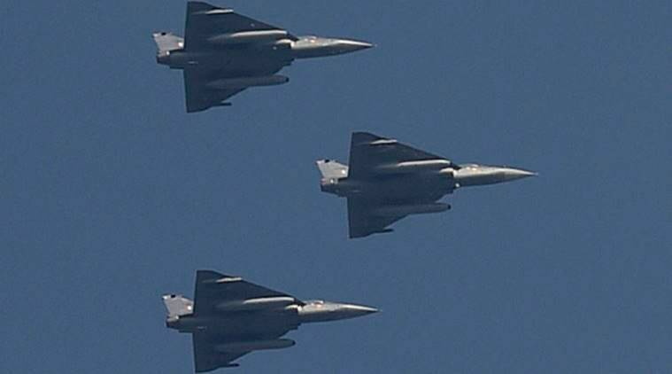 New Delhi: Indian Air Force's Tejas planes flying past for the first time during a full dress rehearsal for the Republic Day Parade at Rajpath in New Delhi on Monday. PTI Photo by Kamal Singh (PTI1_23_2017_000128B)