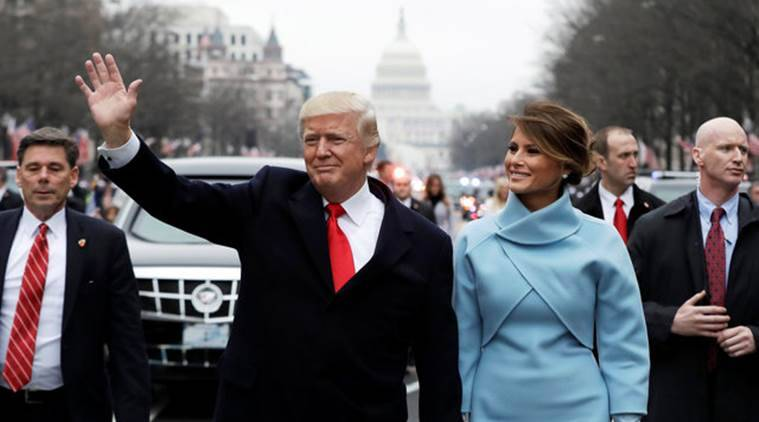 President Donald Trump waves as he walks with first lady Melania Trump during the inauguration parade on Pennsylvania Avenue in Washington, January 20, 2017. REUTERS/Evan Vucci/Pool TPX IMAGES OF THE DAY