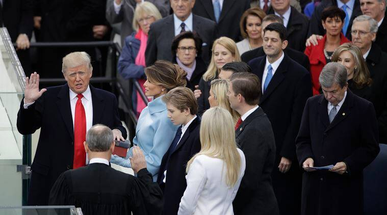 Donald Trump is sworn in as the 45th president of the United States by Chief Justice John Roberts as Melania Trump looks on during the 58th Presidential Inauguration at the U.S. Capitol in Washington, Friday, Jan. 20, 2017. (AP Photo/Matt Rourke)