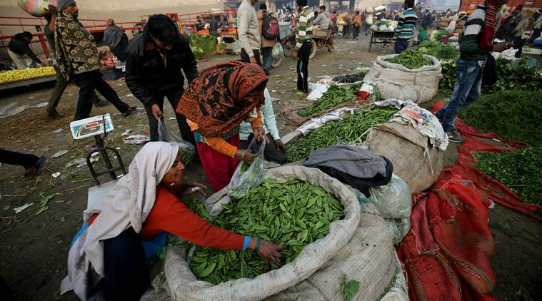 Two female Local Vegetables vendors purchase vegetables from Ghazipur whole sale market after demonetization in New Delhi. EXPRESS PHOTO BY PRAVEEN KHANNA 04 01 2017.