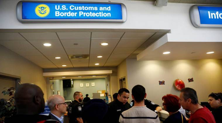 U.S. Customs and Border Protection officers stand outside an office during the travel ban at Los Angeles International Airport (LAX) in Los Angeles, California, U.S., January 28, 2017. REUTERS/Patrick T. Fallon