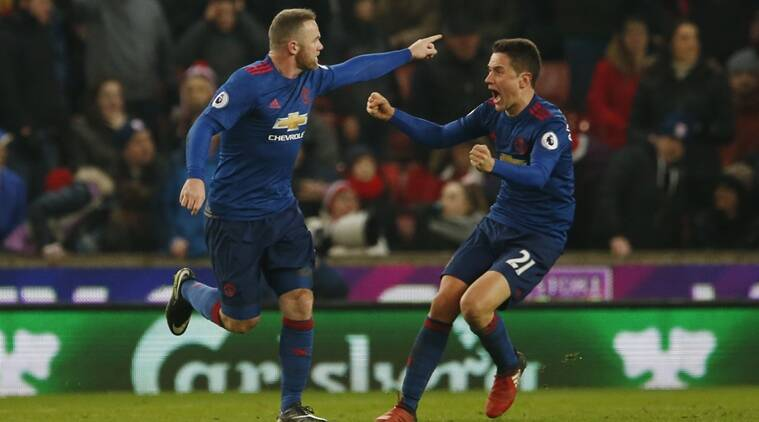 Wayne Rooney sets Manchester United scoring record; Manchester City, Spurs draw