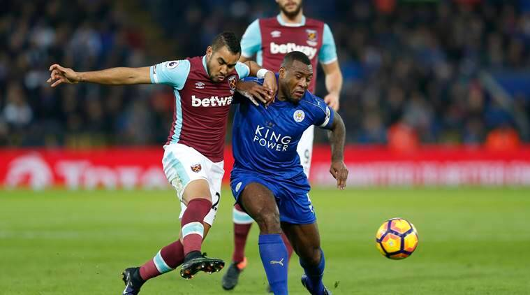 West Ham United's Dimitri Payet in action with Leicester City's Wes Morgan