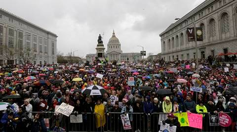 A crowd listens to speakers a rally near City Hall before a women's march during the first full day of Donald Trump's presidency in San Francisco, Saturday, Jan. 21, 2017. (AP Photo/Jeff Chiu)