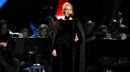 Adele fumbles during Grammy 2017 tribute to George Michael. Curses and starts again