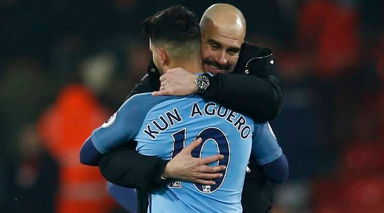 Manchester City manager Pep Guardiola celebrates with Sergio Aguero after the game. Reuters / Peter Nicholls Livepic