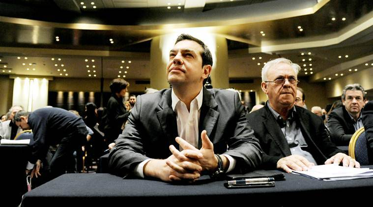 Greek Prime Minister Alexis Tsipras sits next to Deputy Prime Minister Giannis Dragasakis (R) before his speech at the ruling Syriza party central committee in Athens, Greece, February 11, 2017. REUTERS/Michalis Karagiannis     TPX IMAGES OF THE DAY