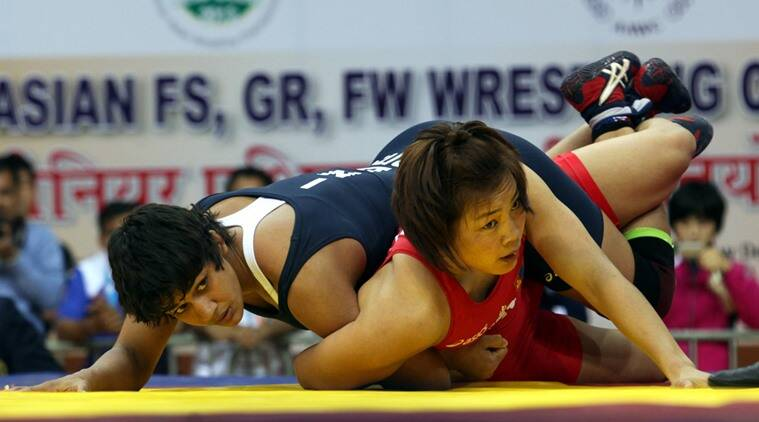 Babita Kumari of India (in blue) and Byambatseren Sundev of Mangolia fights for the 55kg FW bronze during the Senior Asian Wrestling championship at IG stadium in New Delhi on April 20th 2013. Express photo by RAVI KANOJIA.