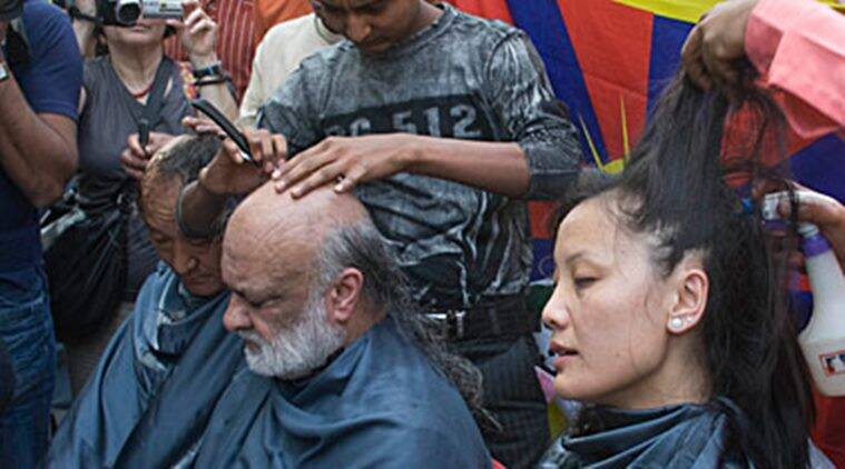 Baljit Malik getting his head shaved in New Delhi in protest against China's crackdown on unrest in Tibet in 2010.