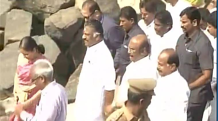 TN CM O Panneerselvam visits Ennore Port to review the clean-up operation that is still on.