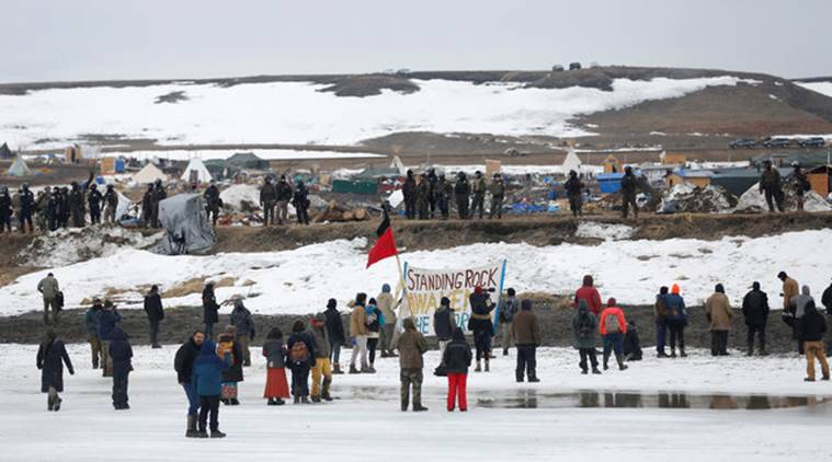Protesters confront police on the outskirts of the main opposition camp against the Dakota Access oil pipeline near Cannon Ball, North Dakota, U.S., February 23, 2017. REUTERS/Terray Sylvester