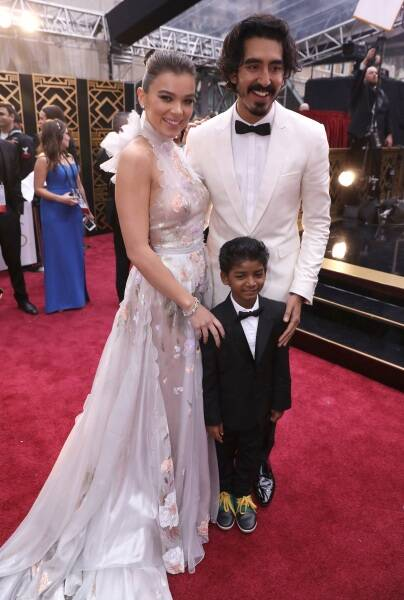 Hailee Steinfeld, from left, Sunny Pawar and Dev Patel arrive at the Oscars on Sunday, Feb. 26, 2017, at the Dolby Theatre in Los Angeles. (Photo by Matt Sayles/Invision/AP)