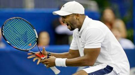 Donald Young celebrates after defeating John Isner in a quarterfinal at the Memphis Open (Source: AP)