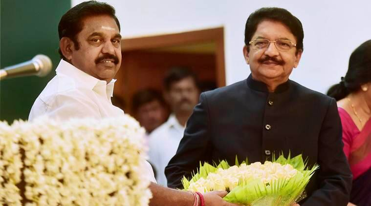 Chennai: Chief Minister 'Edappadi' K Palaniswami being presenting a floral bouquet by Governor CH Vidyasagar Rao after he taking the oath as Chief Minister of Tamil Nadu during the swearing-in ceremony at Raj Bhavan in Chennai on Thursday. PTI Photo R Senthil Kumar(PTI2_16_2017_000213B)