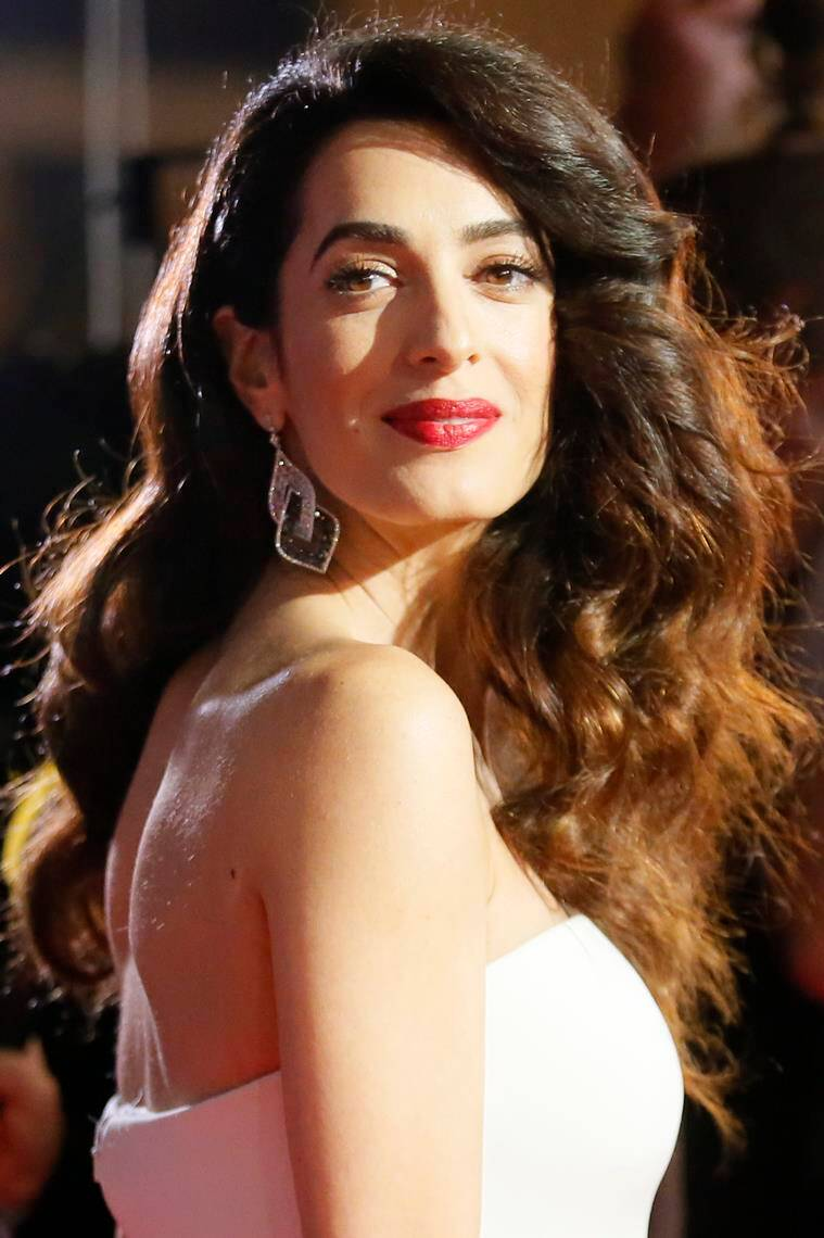 Amal Clooney looked stunning in her Versace gown. (Source: AP)
