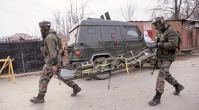 Soldiers with a stretcher in Hajin Tuesday. (AP Photo)