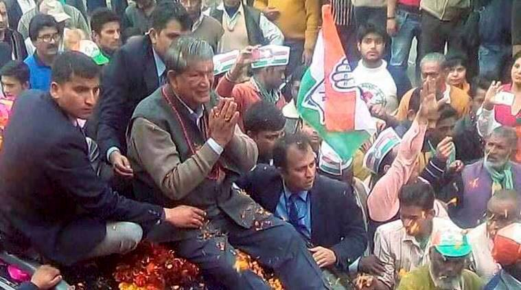 Kashipur : Uttarakhand Chief Minister Harish Rawat during an election campaign road show in Kashipur on Thursday. PTI Photo (PTI2_2_2017_000243B)
