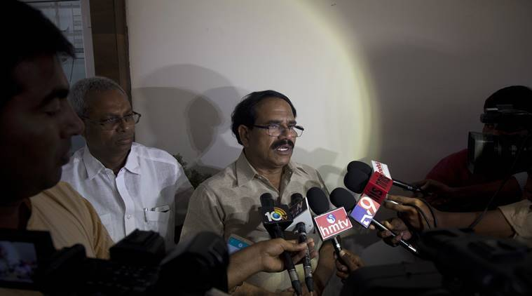 Jaganmohan Reddy, father of Alok Madasani, an engineer who was injured in the shooting Wednesday nighti n a crowded suburban Kansas City bar, speaks to the media at his residence in Hyderabad, India, Friday, Feb. 24, 2017. The shooting of two Indians in the crowded suburban Kansas City bar has sent shock waves through their hometowns, and India's government is rushing diplomats to monitor progress in investigation into the crime. The suspect, Adam Purinton, has been taken into custody and charged on Thursday with murder and attempted murder. (AP Photo/Mahesh Kumar A.)