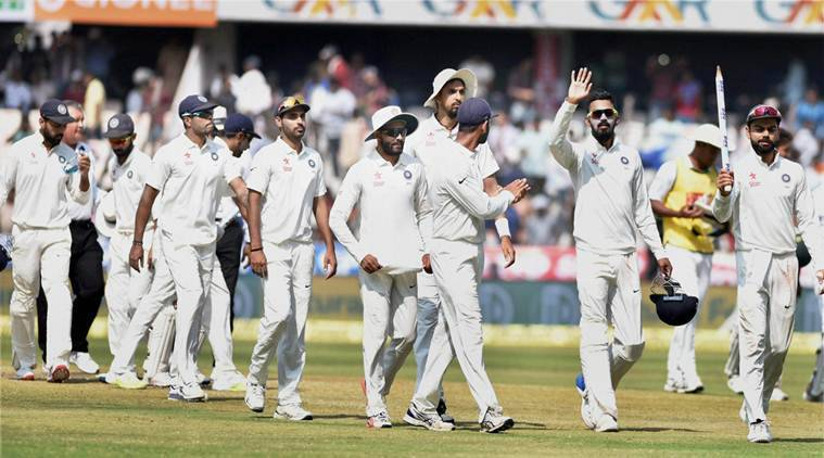 Hyderabad : Indian skipper Virat Kohli with teammates walk off the field after defeating Bangladesh in the cricket test match in Hyderabad on Monday. PTI Photo (PTI2_13_2017_000158A)