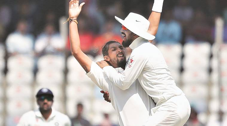 Ishant Sharma celebrates with KL Rahul after taking the wicket of Mahmudullah on Day Five of the first Test. AP
