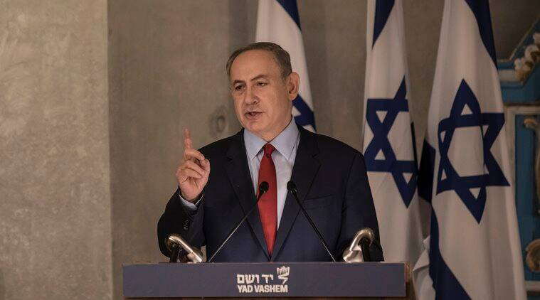 "Israeli Prime Minister Benjamin Netanyahu speaks in the synagogue at the Yad Vashem Holocaust Memorial Museum, in Jerusalem, Thursday, Jan. 26, 2017. In remarks at the Holocaust ceremony on Thursday, Netanyahu said President Donald Trump understands the ""danger"" stemming from the Iran nuclear deal. (AP Photo/Tsafrir Abayov)"
