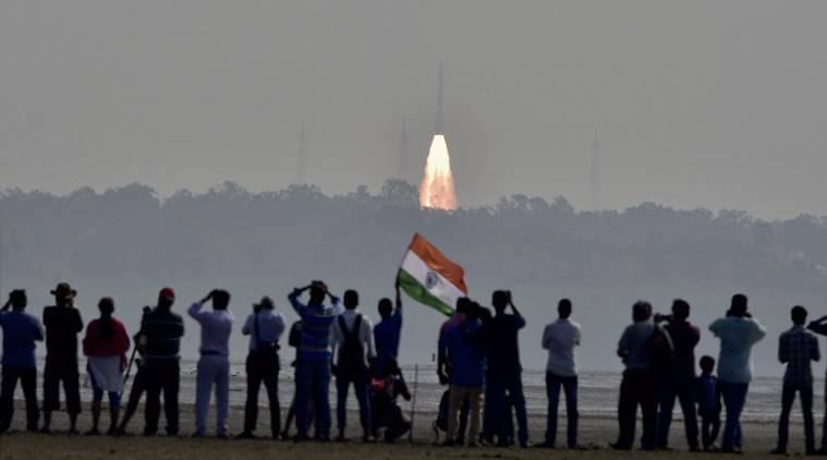 Sriharikota: People watch as as a rocket from Space agency Indian Space Research Organisation (ISRO) takes off successfully to launch a record 104 satellites, including India's earth observation satellite on-board PSLV-C37 from the spaceport of Sriharikota on Wednesday. PTI Photo(PTI2_15_2017_000033B)
