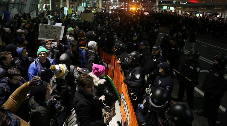 Protesters chant slogans outside Terminal 4 at JFK airport in opposition to U.S. President Donald Trump's proposed ban on immigration and travel in Queens, New York City, New York, U.S. January 28, 2017. REUTERS/Joe Penney