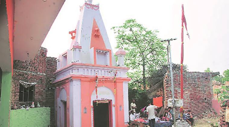 Temple at the centre of the row that triggered violence in 2014 (left); how it looks now. Express