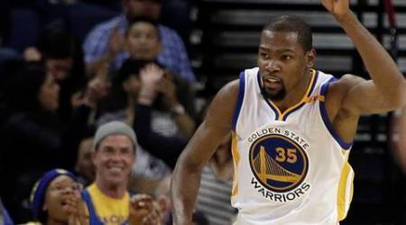 Golden State Warriors' Kevin Durant celebrates a score against the Sacramento Kings during the second half of an NBA basketball game Wednesday, Feb. 15, 2017, in Oakland, Calif. (AP Photo/Ben Margot)
