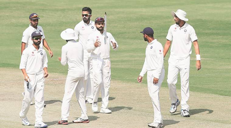 Kohli was made to wait by dogged Bangladesh batsmen before he could collect the souvenir stump. AP