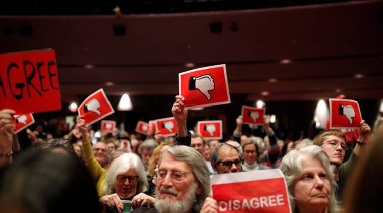 Constituents hold signs in disagreement with U.S. Congressman Leonard Lance (R-NJ 7) during a town hall event at a community college in Branchburg, New Jersey, February 22, 2017.  REUTERS/Dominick Reuter