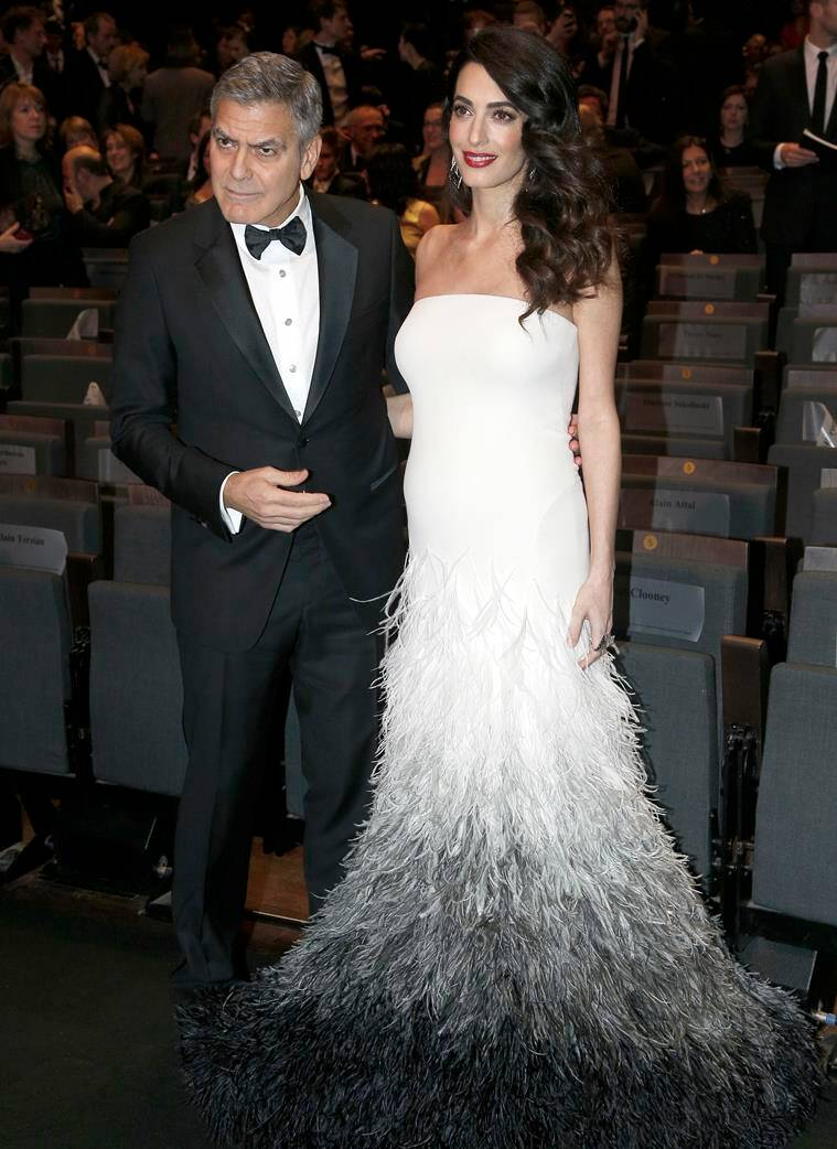 George Clooney and Amal Clooney pose at the 42nd Cesar Film Awards ceremony at Salle Pleyel in Paris. (Source: AP Photo)