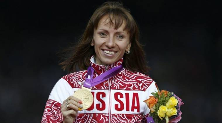 Russia's Savinova holds her gold medal during the women's 800m victory ceremony at the London 2012 Olympic Games