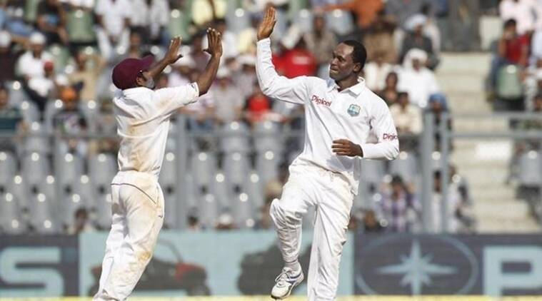 West Indies' Samuels and Barath celebrate the dismissal of India's Dravid during their third test cricket match in Mumbai