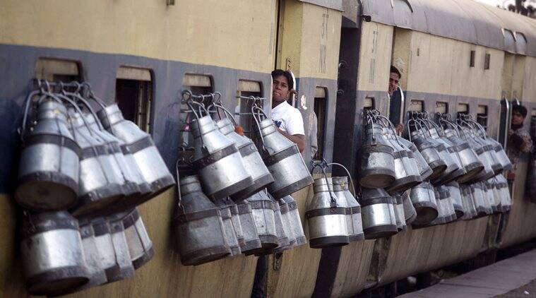 """Milk containers hang from the windows of a passenger train in Ghaziabad on the outskirts of New Delhi in this March 14, 2012 file photograph. By the end of the day, about 40 people on average will have died somewhere on the network of 64,000 km (39,800 miles) of track. Many will be slum-dwellers and poor villagers who live near the lines and use them as places to wash and as open toilets. Some will have fallen off overcrowded commuter trains. Of the 20 million people who travel daily on the network, many will arrive hours, even a day, behind schedule, having clattered along tracks and been guided by signalling systems built before India gained independence from Britain in 1947."" *** Local Caption *** ""Milk containers hang from the windows of a passenger train in Ghaziabad on the outskirts of New Delhi in this March 14, 2012 file photograph. By the end of the day, about 40 people on average will have died somewhere on the network of 64,000 km (39,800 miles) of track. Many will be slum-dwellers and poor villagers who live near the lines and use them as places to wash and as open toilets. Some will have fallen off overcrowded commuter trains. Of the 20 million people who travel daily on the network, many will arrive hours, even a day, behind schedule, having clattered along tracks and been guided by signalling systems built before India gained independence from Britain in 1947. To match Insight INDIA-RAILWAYS REUTERS"""
