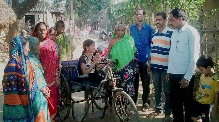 Kendrapara: Wheelchair-bound Minati Barik canvassing in Bajapur village in Odisha's Kendrapara district for the upcoming Panchayat polls on Sunday. PTI Photo(PTI2_5_2017_000179B) (Plese see CES 11)