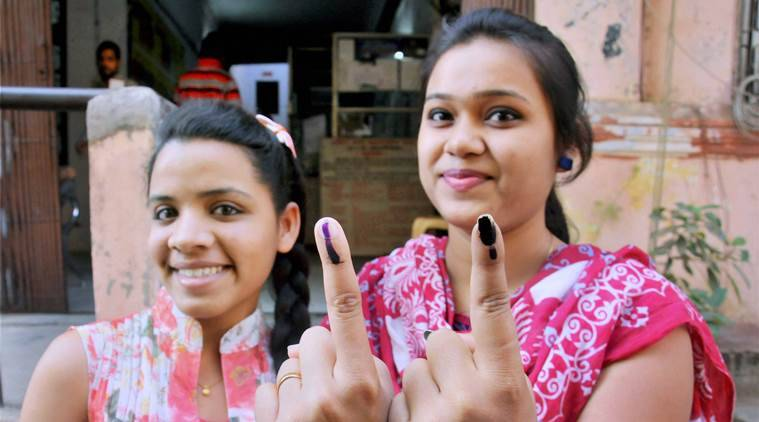 Nagpur: First time voters showing their ink marked fingers after casting votes at a polling station for the Municipal Corporation election in Nagpur on Tuesday. PTI Photo(PTI2_21_2017_000174A)