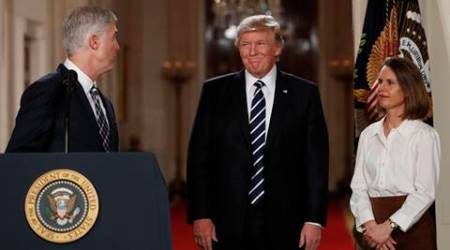 Judge Neil Gorsuch turns to look at President Donald Trump in the East Room of the White House in Washington, Tuesday, Jan. 31, 2017, after Trump announced Gorsuch as his nominee for the Supreme Court. Gorsuch's wife Louise watches. (AP Photo/Carolyn Kaster)